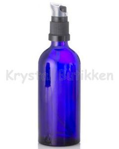 Blå glasflaske med lotion pumpe
